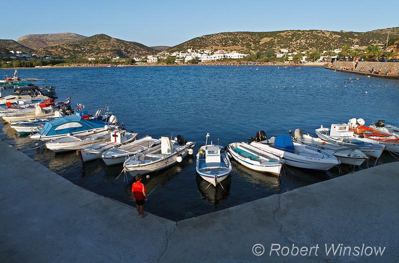 Boy fishing from Pier, Boats, Harbor and Beach, Galissas, Island of Syros, Aegean Sea, Cyclade Islands, Greece