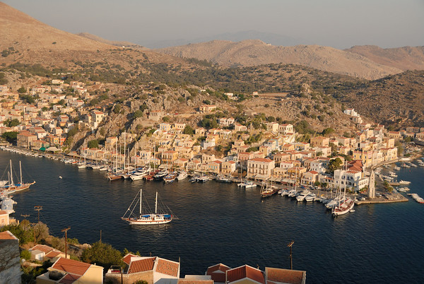 Early morning lights up Symi harbor in Dodecanese, Greece