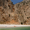 Secluded beach for sunbathers in Symi, Dodecanese, Greece