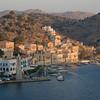 Sunrise arrives in Symi harbor in Dodecanese, Greece