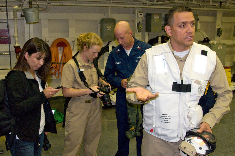 Gina, LT Shultis, Petty Officer Carlson and CDR Zamora welcoming our party aboard the USS Green Bay