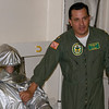 Air Boss LCDR Rocha showing the fire suit on the USS Green Bay