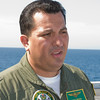 Air Boss LCDR Rocha on the flight deck of the USS Green Bay