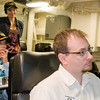 Deb, Ponzi and Jake listening to our initial briefing in the pilot briefing room on board the USS Green Bay
