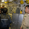 Walking to the pilot's briefing room on board the USS Green Bay with Master Chief