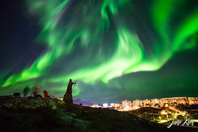 Northern Lights over the statue of Hans Egede in Nuuk