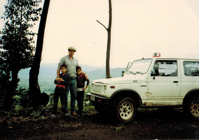 My brother Nick and I and Dad in 1986 in Rwanda.  This was before Suzuki Samuris were imported into the US. We loved this car so much we bought one in the USA. It was the first new car my dad ever bought.