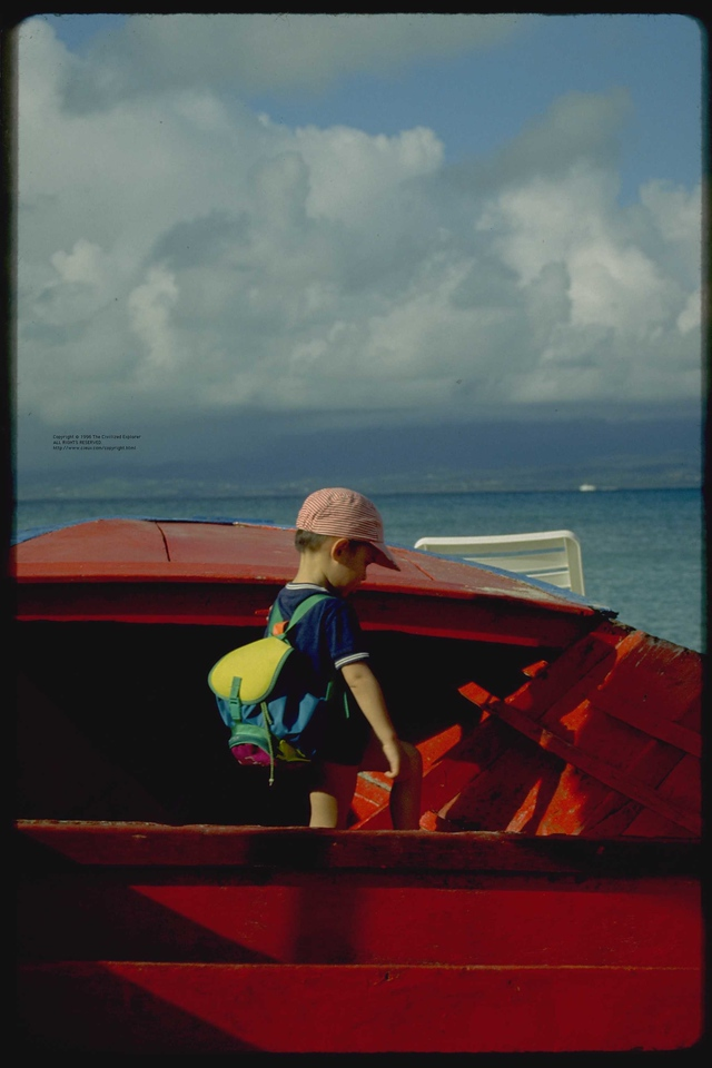 A boy and his boat on the beach at Le Gosier.
