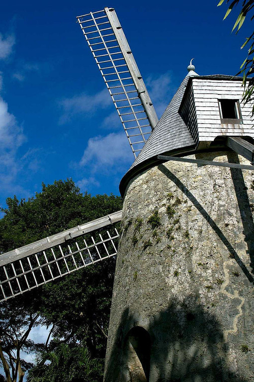 An old windmill formerly used to grind sugar cane has been relocated and refurbished at Distillerie Damoiseau