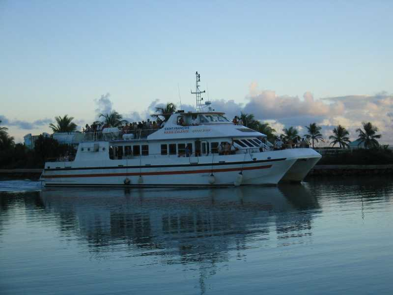 An evening ferry heading to the dock at the mariina in St. Francois, Guadeloupe.