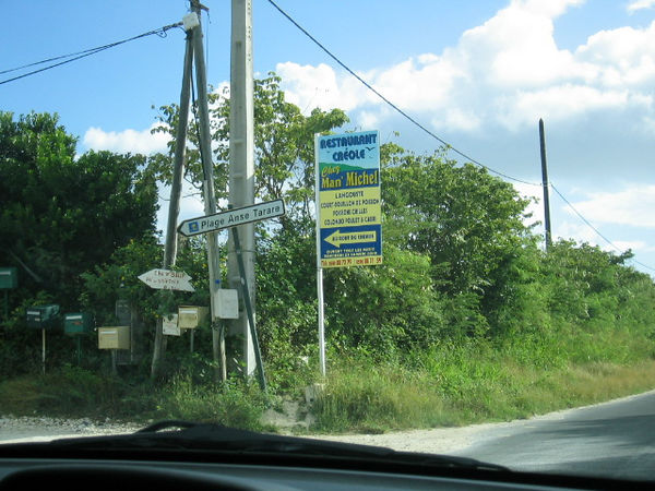 "This is the signpost to Pointe Tarare (a naturist beach), as of January 2005. It seems to change every time we visit. We do not have the coordinates for this particular intersection; we do have this photo geotagged for the beach. Click ""Map This!"" for its location on Google."
