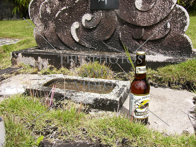 An offering by the headstone at the South Pacific Memorial Peace Park in Yigo, Guam island.