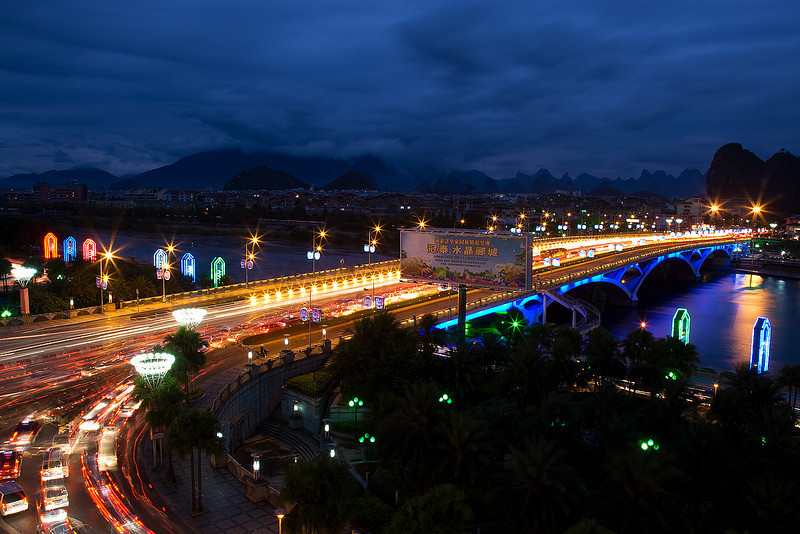 Jiefang Bridge as seen from the Universal Guilin Hotel at dusk. The beautiful karst landscape could be seen in the background.