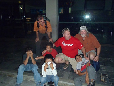 Tres hermanos with street urchins at Guatemala City Airport