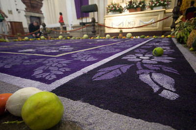 "Iglesia La Merced. This is made of saw-dust tinted in different colors. The ""alfombra"" (carpet) is made during lent and it is changed every few days. Also, fruits and vegetebles are placed as offerings around it.  Antigua, Guatemala"