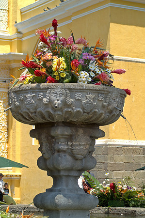 Fountain with a large flower bouquet in front of the church of La Merced (1548). The flowers for the Easter celebrations in Antigua Guatemala are traditionally sponsored by the Mayor