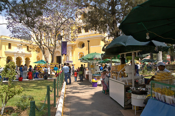 Food vendors set up their stands in the park of the church of La Merced (1548)., Anitgua Guatemala