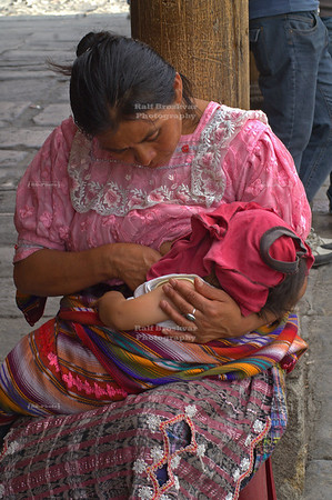 Maya woman breastfeeding her infant child La Antigua Guatemala, UNESCO World Cultural Heritage