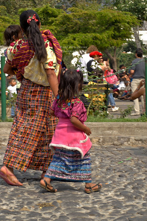 Indigenous Maya woman crossing the street with her 2 children La Antigua Guatemala, UNESCO World Cultural Heritage