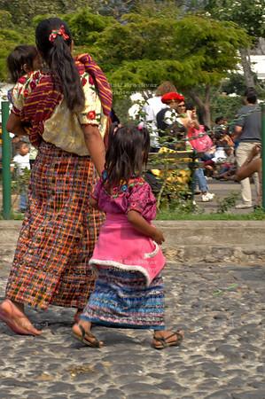 Indigenous Maya woman crossing the street with her 2 children La Antigua Guatemala, UNESCO World Cultural Heritage