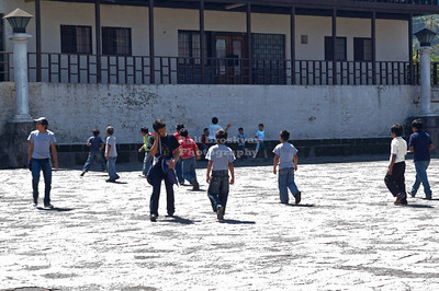 School kids playing soccer on the courtyard of Iglesia Parroquial Santiago Apostol in Santiago Atitlán, Guatemala
