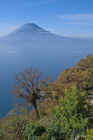 The twins - volcan de Toliman and volcan de Atitlán towering over Lake Atitlán in the highlands of Guatemala