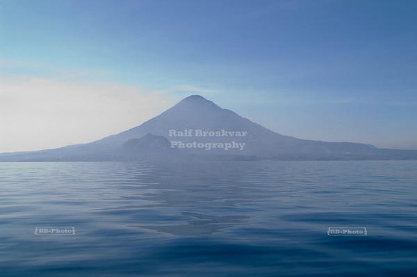 Volcan de Toliman (Toliman volcano) fading into the haze on Lago de Atitlán (Lake Atitlán), Guatemala
