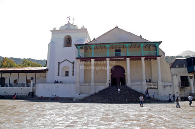 Iglesia Parroquial Santiago Apostol in Santiago Atitlán with school kids playing soccer. The church was founded in 1547 and the structure was completed in 1582