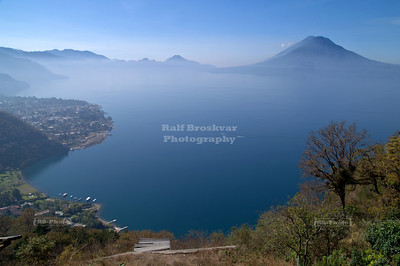 View over Lake Atitlán. The two cones next to each other on the right are volcanoes Toliman (front) and Atitlán (back). The village to the left is Panajachel