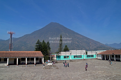 Courtyard of the Iglesia Parroquial Santiago Apostol in Santiago Atitlán with volcano San Pedro in the background
