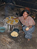 Enjoying the process of making the tortillas, the room was filled with other woman and they were all working happily together.
