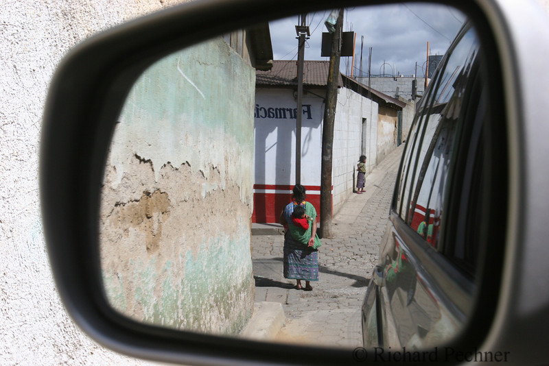 Rear view mirror shot, woman and child