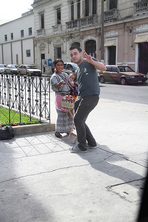 Any place where there is an open piece of sidewalk, someone will set up shop. This lady is selling lollipops (I think).