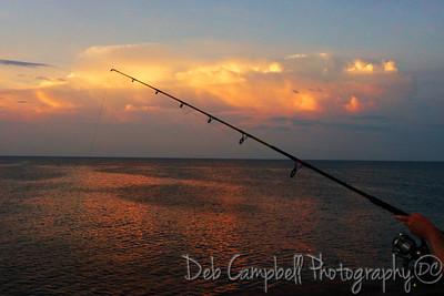 Fishing at sunrise/Gulf State Park Pier Gulf Shores, Alabama