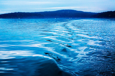 The wake of the Spirit Quest makes an artful pattern in the calm waters off the Gulf Islands of Canada.