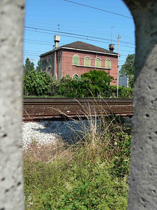 A view of a house by the train tracks across from the shipyard