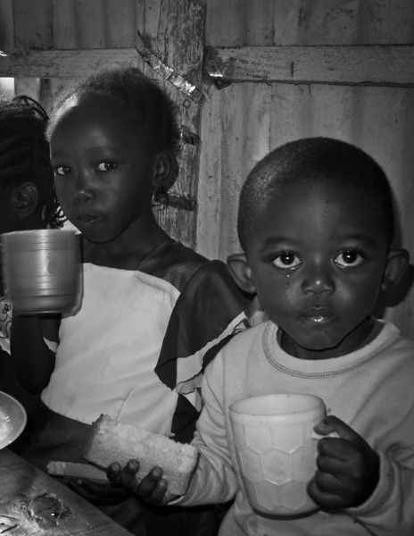 The children were treated to chai and bread this morning. These two have a look of apprehension on their face.