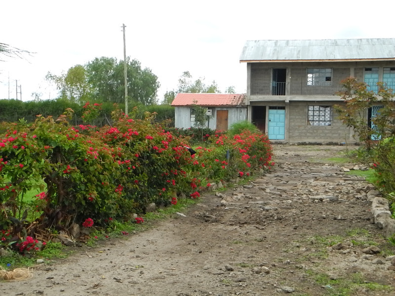 On left is the preschool and bottom floor of cement block building is the boys' dorm. Upstairs is the library and Christine's office (Director).