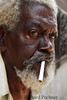 Bloodshot eyed man with cigarette in mouth
