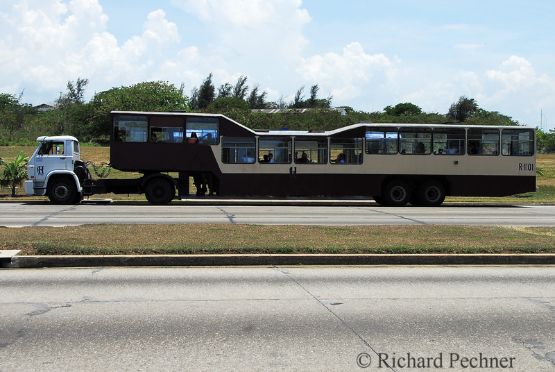 "Infamous ""Camel"" bus, broken down, outside Havana."