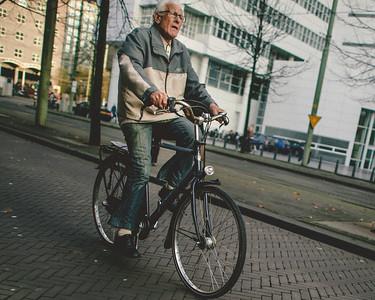 A Man Bikes Downtown
