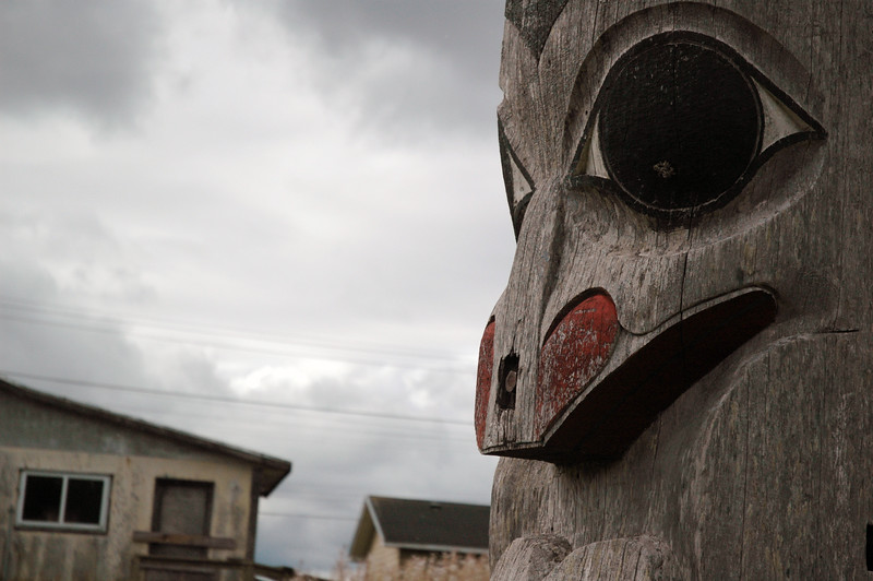 """Haida Gwaii (formerly known as the Queen Charlotte Islands) in British Columbia<br /> <br /> These photographs show Haida and Tlingit totem art and carvings from Victoria, the Queen Charlotte Islands and Haines, Alasaka. The west coast is rich in Haida and Tlingit art; however, most of the totems you'll find in villages and towns were created within the last 50 years or so, even though aboriginal communities have lived and carved on the west coast for time immemorable. European settlers believed totems were heathen and destroyed most of them in British Columbia -- as a result, very few original totems remain. There are a few villages along the Queen Charlotte Islands where you will find the remains of some old Haida villages. The villages were abandoned in the late 1800s reduced the Haida population from about 10,000 to a mere 300 (one European man landed on Charlotte soil *knowingly* carrying small pox). After the outbreak, the Haida moved to the northern parts of the islands in towns like Massett and Skidegate. Most poles are raised at a ceremony called a potlatch, where the family presented gifts to everyone attending. A family would have to accumulate great wealth in order to hold a potlatch - and wealth was shown by """"giving away"""" rather than """"accumulating"""" possessions. Memorial totems (many of which housed the dead) would be left to rot and naturally succum to the earth -- all part of the reincarnation beliefs of the Haida people. Unfortunately, many totems (in effect tombs) were exported/imported to museums around the world. The Haida are now asking for repatriation and a return of their ancestor's bones. Haida representatives recently went to Chicago and reclaimed bones from the musuem there. The Canadian government and Haida nation are now in the process of buildling a $20 million museum to house Haida artifacts on the Queen Charlotte Islands. <br /> <br /> <br /> <br /> <br /> Travel Stock Photography for the Nature Stock Photography Library by Professional"""