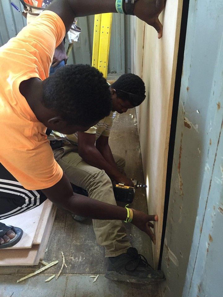 Day #4<br /> Louinerge helping install the wall panels.
