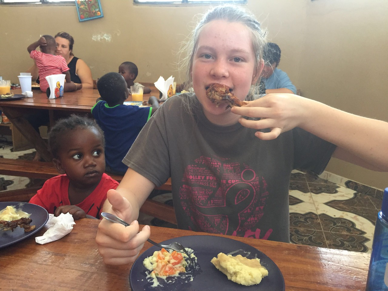 Day #4<br /> Lunch at the team house. <br /> Hailey & Lucas enjoying some chicken