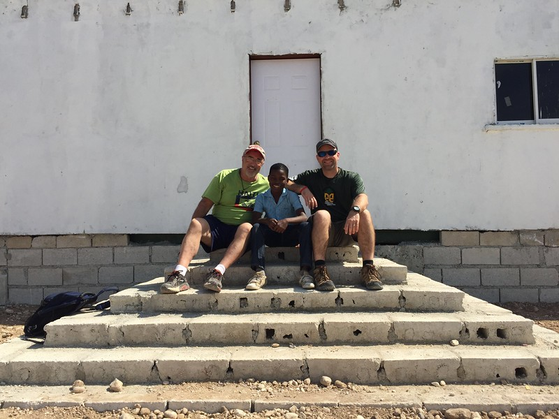 Jim, Richard and I.<br /> Richard worked so hard with us in the office all week. He was so proud of his work and Jim and I both were proud to call him our helper.<br /> We told him our last goodbyes for this trip and grabbed a photo on the steps of the office.