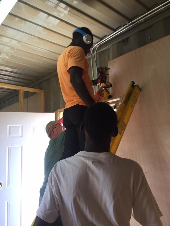 Jim & Manes installing more wall panels