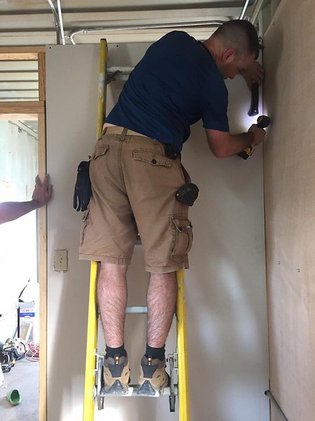 "It was ""back to work"" after lunch. Me, installing a section of drywall.<br /> Photo credit: Louinerge"