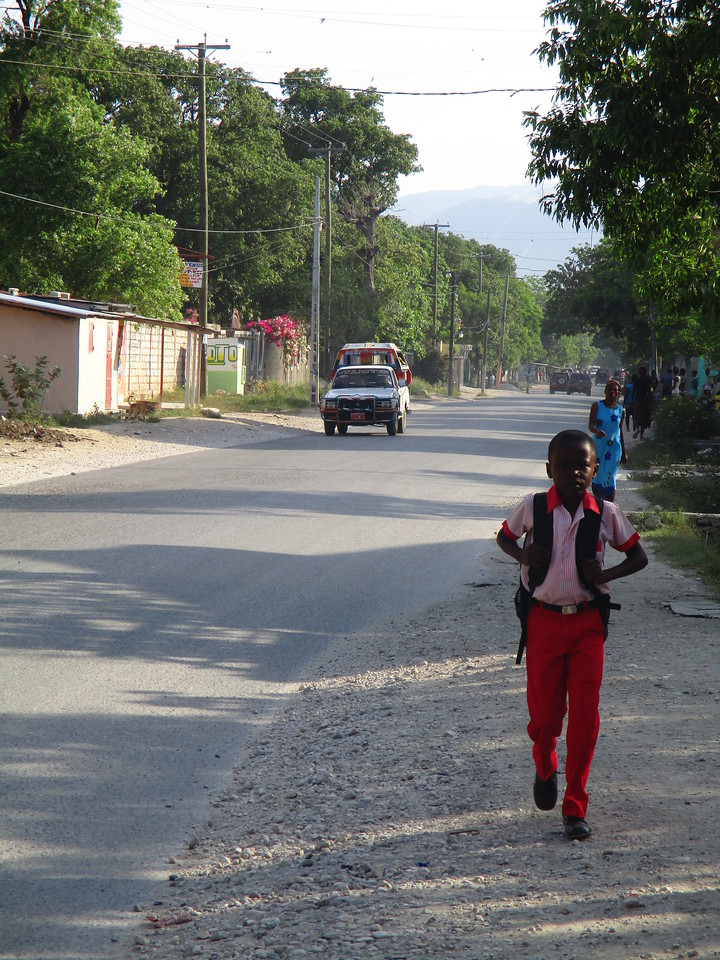 Walking to school.<br /> Although this kid faces many various problems on an given day, this picture shows that he does not have to walk up-hill both ways to/from school.