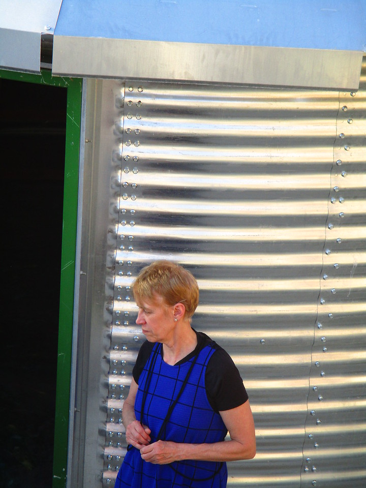 "Holly inspecting one of the new ""grain bin"" homes at the rear of the team house.<br /> They are Safe-T homes manufactured by  Sukup"