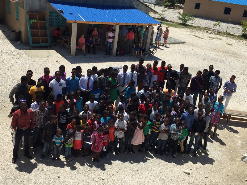 DAY 8<br /> Imigaine Missions family picture after church.<br /> *Taken from the balcony of the new school